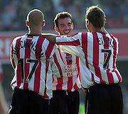 20/09/2003.Nationwide Div 2 Brentford v Hartlepool..Brentford players [Kevin O'Conner middle] celebrate victory over Hartlepool [2-1]