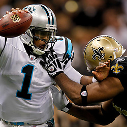 January 1, 2012; New Orleans, LA, USA; New Orleans Saints defensive end Cameron Jordan (94) grabs Carolina Panthers quarterback Cam Newton (1) as he scrambles during the first quarter of a game at the Mercedes-Benz Superdome. Mandatory Credit: Derick E. Hingle-US PRESSWIRE