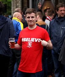 A Middlesbrough fan has a prematch drink - Photo mandatory by-line: Robbie Stephenson/JMP - Mobile: 07966 386802 - 08/05/2015 - SPORT - Football - Brentford - Griffin Park - Brentford v Middlesbrough - Sky Bet Championship