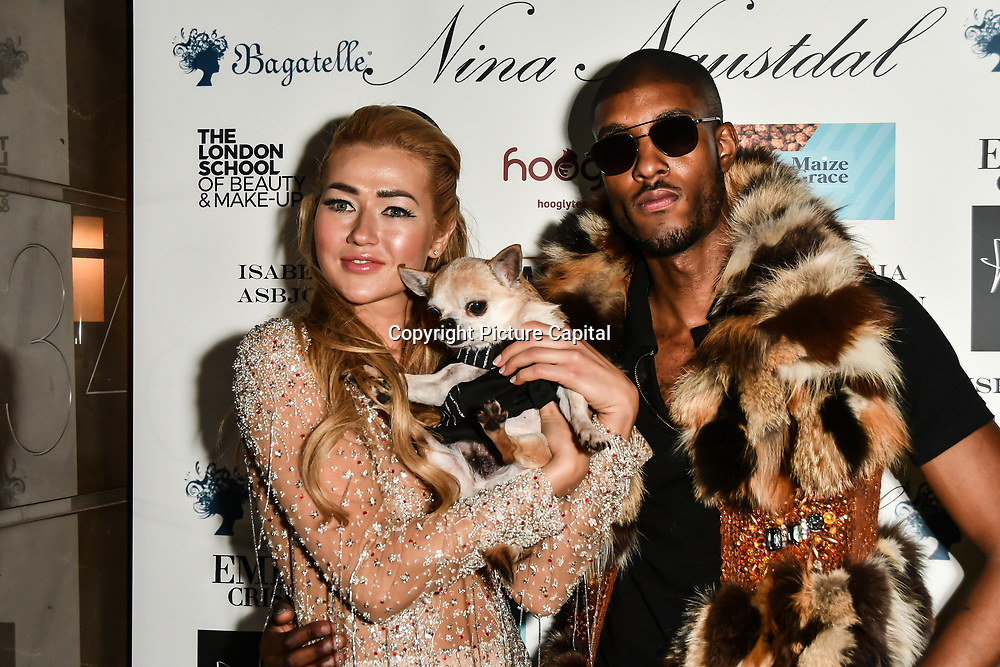 Angelina Kali and Stefan-Pierre Tomlin modelling for Nina Naustdal catwalk show SS19/20 collection by The London School of Beauty & Make-up at Bagatelle on 26 Feb 2019, London, UK.