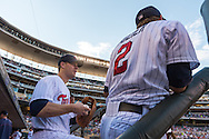 Justin Morneau #33 and Brian Dozier #2 of the Minnesota Twins talk on the steps of the dugout before a game against the Kansas City Royals on June 27, 2013 at Target Field in Minneapolis, Minnesota.  The Twins defeated the Royals 3 to 1.  Photo by Ben Krause