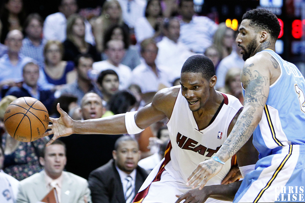 19 March 2011: Miami Heat power forward Chris Bosh (1) loses the ball against Denver Nuggets small forward Wilson Chandler (21)during the Miami Heat 103-98 victory over the Denver Nuggets at the AmericanAirlines Arena, Miami, Florida, USA.