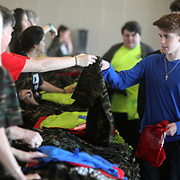 Jon Paul Porter, a ninth grader at West Union High School, gets his shirt and backpack upon arrvial to the BancorpSouth Arena for the Healthy Teens Rally sponsored by The Family Resource Center.
