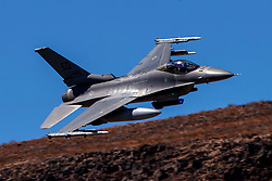 United States Air Force General Dynamics F-16C Fighting Falcon (88-0445) from the 412th Test Wing, 416th Flight Test Squadron, Edwards Air Force Base, California, flies low level on the Jedi Transition through Star Wars Canyon / Rainbow Canyon, Death Valley National Park, Panamint Springs, California, United States of America