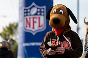 Cleveland Browns fans wearing a dogs hat stands outside Twickenham on his phone during the International Series match between Cleveland Browns and Minnesota Vikings at Twickenham, Richmond, United Kingdom on 29 October 2017. Photo by Jason Brown.