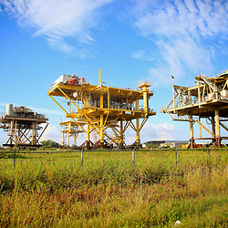 A abandoned production platform sits on land waiting to be sold at the Port of Iberia, Louisiana, U.S., on Friday, August 19, 2016.  Photographer: Derick E. Hingle/Bloomberg