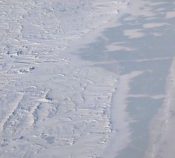 April 16, 2019 - Bengal - Petermann Pond during research flights for NASA's Operation IceBridge now in its final year after a decade of airborne missions to map polar ice. Frozen meltwater lake in the Lambert Land region of northeastern Greenland, between the Zacharia Isstrom and 79N glaciers. (Credit Image: © NASA Earth Observatory/ZUMA Wire/ZUMAPRESS.com)