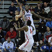 Delaware 87ers Forward Victor Rudd (23) and Erie BayHawks Guard Seth Curry (12) battle for the rebound in the first half of a NBA D-league regular season basketball game between the Delaware 87ers and the Erie BayHawk (Orlando magic) Friday, Jan. 02, 2015 at The Bob Carpenter Sports Convocation Center in Newark, DEL