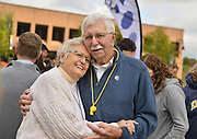 "Chuck and Nora Kegley, '56, embrace during the ""Kiss on the K."" they met on a beach in Florida during Spring Breeak."