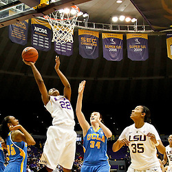 December 13, 2011; Baton Rouge, LA; LSU Lady Tigers forward Courtney Jones (22) shoots over UCLA Bruins center Corinne Costa (34) and guard Rebekah Gardner (35) during the first half of a game at the Pete Maravich Assembly Center.  Mandatory Credit: Derick E. Hingle-US PRESSWIRE