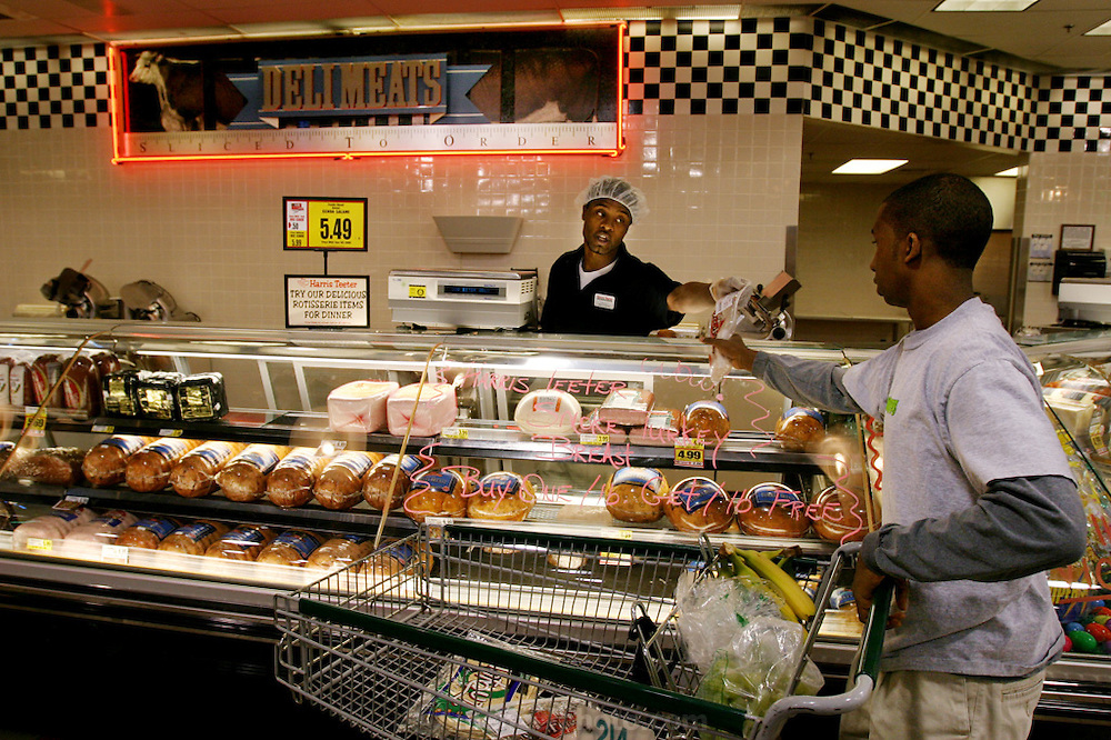 Shopping for a weeks' worth of food, Brandon picks up some meat from the local Harris Teeter Deli. (Supporting image from the project Hungry Planet: What the World Eats.) The Revis family of Raleigh, North Carolina, is one of the thirty families featured, with a weeks' worth of food, in the book Hungry Planet: What the World Eats.