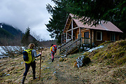 Hikers approach the  Eagle Glacier Cabin in the Tongass National Forest north of Juneau, Alaska, April 20, 2017. <br /> Photo by David Lienemann