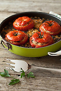 Pan with tomatoes filled with rice and chard, typical summer recipe of vegetarian cuisine.