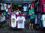 24 JULY 2018 - BANGKOK, THAILAND: A vender sets up his tee shirt stall on Khao San Road in Bangkok. Khao San Road is Bangkok's original backpacker district and is still a popular hub for travelers, with an active night market and many street food stalls. The Bangkok municipal government plans to shut down the street market by early August because city officials say the venders, who set up on sidewalks and public streets, pose a threat to public safety and could impede emergency vehicles. It's the latest in a series of night markets and street markets the city has closed.   PHOTO BY JACK KURTZ