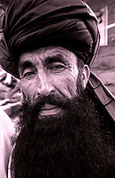 Khost, 20 August 2005.Portrait of Afghan man wearing a black turban