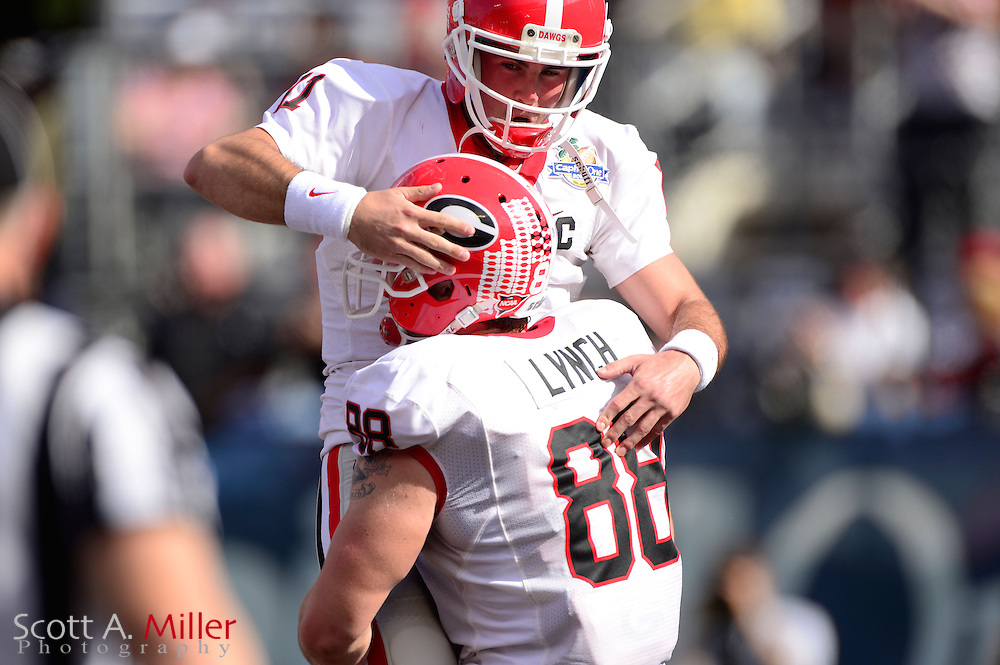 Georgia Bulldogs safety Connor Norman (11) and tight end Arthur Lynch (88) celebrate a touchdown during the first half against the Nebraska Cornhuskers in the Capital One Bowl at the Florida Citrus Bowl on Jan 1, 2013 in Orlando, Florida. ..©2012 Scott A. Miller..