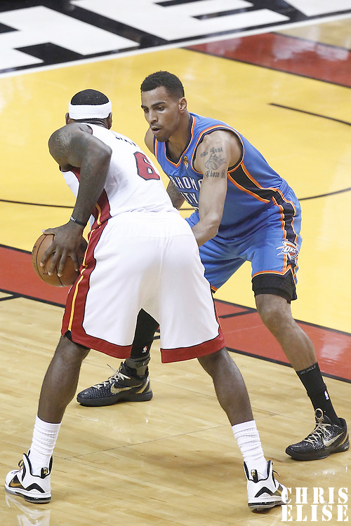 21 June 2012: Oklahoma City Thunder shooting guard Thabo Sefolosha (2) defends on Miami Heat small forward LeBron James (6) during the Miami Heat 121-106 victory over the Oklahoma City Thunder, in Game 5 of the 2012 NBA Finals, at the AmericanAirlinesArena, Miami, Florida, USA. The Miami Heat wins the series 4-1.