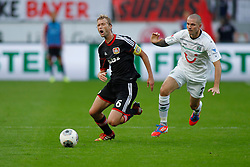 28.09.2013, BayArena, Leverkusen, GER, 1. FBL, Bayer 04 Leverkusen vs Hannover 96, 7. Runde, im Bild Simon Rolfes #6 (Bayer 04 Leverkusen) wird von Leon Andreasen #2 (Hannover 96) gefoult. (v.l.). Aktion, Action // during the German Bundesliga 7th round match between Bayer 04 Leverkusen and Hannover at the BayArena, Leverkusen, Germany on 2013/09/28. EXPA Pictures © 2013, PhotoCredit: EXPA/ Eibner/ Grimme<br /> <br /> ***** ATTENTION - OUT OF GER *****