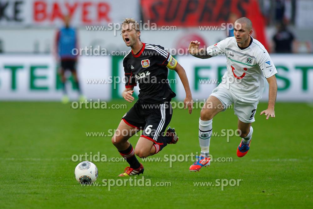 28.09.2013, BayArena, Leverkusen, GER, 1. FBL, Bayer 04 Leverkusen vs Hannover 96, 7. Runde, im Bild Simon Rolfes #6 (Bayer 04 Leverkusen) wird von Leon Andreasen #2 (Hannover 96) gefoult. (v.l.). Aktion, Action // during the German Bundesliga 7th round match between Bayer 04 Leverkusen and Hannover at the BayArena, Leverkusen, Germany on 2013/09/28. EXPA Pictures &copy; 2013, PhotoCredit: EXPA/ Eibner/ Grimme<br /> <br /> ***** ATTENTION - OUT OF GER *****