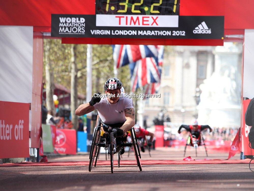 22.04.2012 London, England. David Weir (Great Britain & NI) seen crossing the finish line in front of Buckingham Palace in The Mall wins the Wheelchair event at The Virgin London Marathon in a time of 1:32:20