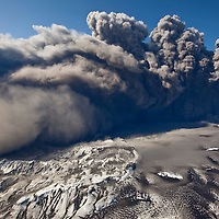 Iceland, Hvolsvelli,  Aerial view of masive ash plume erupting through 200 meter thick glacial ice sheet at summit of Eyjafjallajökull Volcano