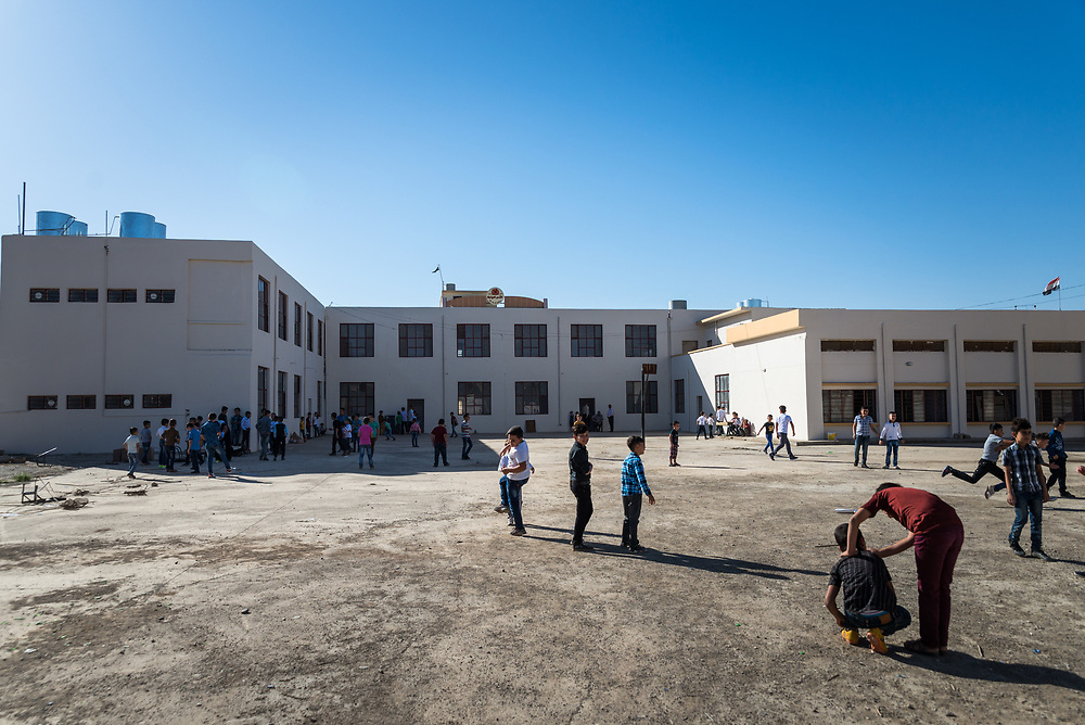 11 October 2017 &ndash; Ninewa Plains &ndash; Boys play in the courtyard of the Al-Taghllubia School for Boys in the Ninewa Plains.<br /> <br /> UNDP&rsquo;s Funding Facility for Stabilization is helping rehabilitate the school, which suffered damage during ISIL occupation and the battle to retake the town. After being closed for 3 years it reopened its doors to students today. Miss Fatim, a parent of one of the school&rsquo;s pupils is happy to see her son return to the school. &ldquo;It&rsquo;s very nice to come back to your original place,&rdquo; she said. &ldquo;We appreciate this so much. It&rsquo;s a very nice feeling to see you are here and are helping us, and that students can come back here to study.&rdquo;<br /> <br /> &copy; UNDP Iraq / Claire Thomas