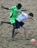 09 December 2006, South African Jury Mtwa tussles with Englands Alex Breingan during their game at the Vodacom Pro Beach Soccer Tour in Durban's Bay of Plenty on Saturday. England won the game 3-1. Picture: Shayne Robinson, PhotoWire Africa