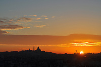 Paris, View across the city to Sacre Coeur - sunrise.