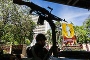 "20 MAY 2104 - BANGKOK, THAILAND:  A Thai army checkpoint in front of a portrait of Bhumibol Adulyadej, the King of Thailand, at the National Police headquarters on Rama I Road in Bangkok. The army has taken over public security functions from the police and ordered many of the police units to stand down. The Thai Army declared martial law throughout Thailand in response to growing political tensions between anti-government protests led by Suthep Thaugsuban and pro-government protests led by the ""Red Shirts"" who support ousted Prime Minister Yingluck Shinawatra. Despite the declaration of martial law, daily life went on in Bangkok in a normal fashion. There were small isolated protests against martial law, which some Thais called a coup, but there was no violence.  PHOTO BY JACK KURTZ"