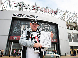 A Derby County fan holds up a page of signatures he has collected - Photo mandatory by-line: Dougie Allward/JMP - Mobile: 07966 386802 30/08/2014 - SPORT - FOOTBALL - Derby - iPro Stadium - Derby County v Ipswich Town - Sky Bet Championship