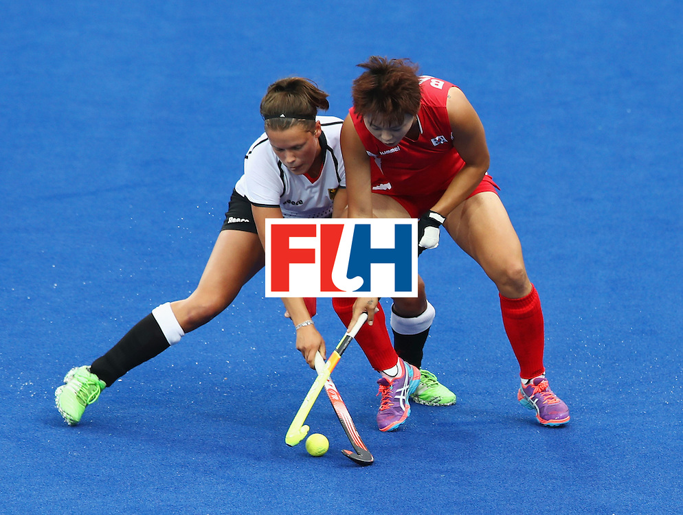 RIO DE JANEIRO, BRAZIL - AUGUST 10:  Charlotte Stapenhorst of Germany and Eeseul Baek of Korea battle for the ball during the Women's Pool B Match between Germany and Korea on Day 5 of the Rio 2016 Olympic Games at the Olympic Hockey Centre on August 10, 2016 in Rio de Janeiro, Brazil.  (Photo by Mark Kolbe/Getty Images)