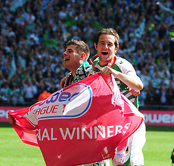 Yeovil Town's Joe Edwards and Matthew Dolan celebrate Yeovil Town's promotion into the Npower Championship after winning the League 1 Play-Off Final  - Photo mandatory by-line: Dougie Allward/JMP - Tel: Mobile: 07966 386802 19/05/2013 - SPORT - FOOTBALL - LEAGUE 1 - PLAY OFF - FINAL - Wembley Stadium - London - Brentford V Yeovil Town
