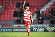 Doncaster Rovers Midfielder James Coppinger (26) gestures towards the Doncaster fans during the The FA Cup match between Doncaster Rovers and Scunthorpe United at the Keepmoat Stadium, Doncaster, England on 3 December 2017. Photo by Craig Zadoroznyj.