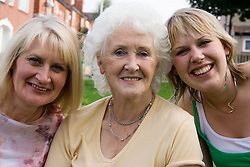 Three generations of women; smiling,