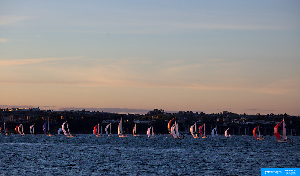 Yacht's sailing in the Hauraki Gulf in Auckland Harbour at sunset. Auckland, North Island. New Zealand, 3rd November 2010. Photo Tim Clayton