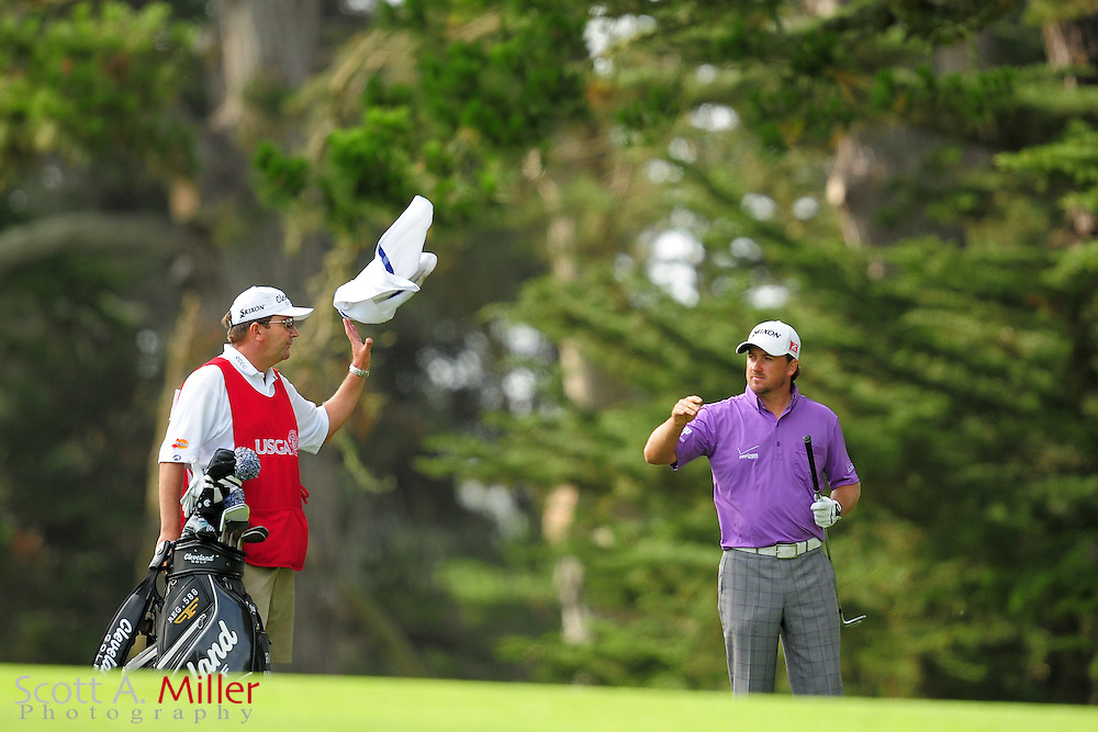 Graeme McDowell tosses a towell to his caddie Ken Comboy during the third round of the 112th U.S. Open at The Olympic Club on June 16, 2012 in San Fransisco. ..©2012 Scott A. Miller