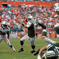 Jets quarterback Mark Sanchez (6) scrambles during an NFL football game between the New York Jets and the Miami Dolphins on Sunday, September 23, 2012 at SunLife Stadium in Miami, Florida. (AP Photo/Alex Menendez)