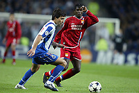 FOOTBALL - CHAMPIONS LEAGUE CUP 2003/04 - 1/4 FINAL 1ST LEG - 23/03/2004 - FC PORTO v OLYMPIQUE LYONNAIS - DECO (POR) / MAHAMADOU DIARRA (LYON) - PHOTO JEAN MARIE HERVIO / DIGITALSPORT