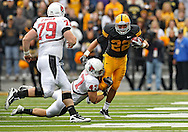 September 25 2010: Iowa Hawkeyes returner Colin Sandeman (22) tries to pull away from Ball State Cardinals linebacker Tony Martin (47) during the first half of the NCAA football game between the Ball State Cardinals and the Iowa Hawkeyes at Kinnick Stadium in Iowa City, Iowa on Saturday September 25, 2010. Iowa defeated Ball State 45-0.
