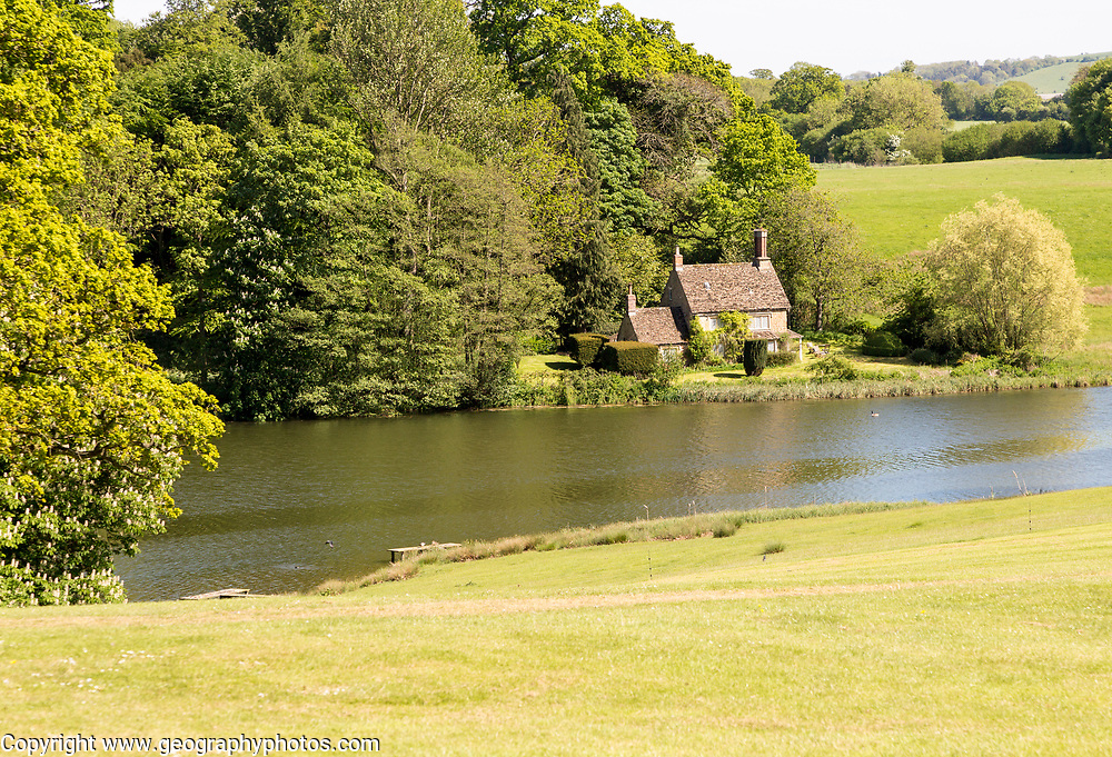 Lakeside cottage lake at Bowood House and gardens, Calne, Wiltshire, England, UK