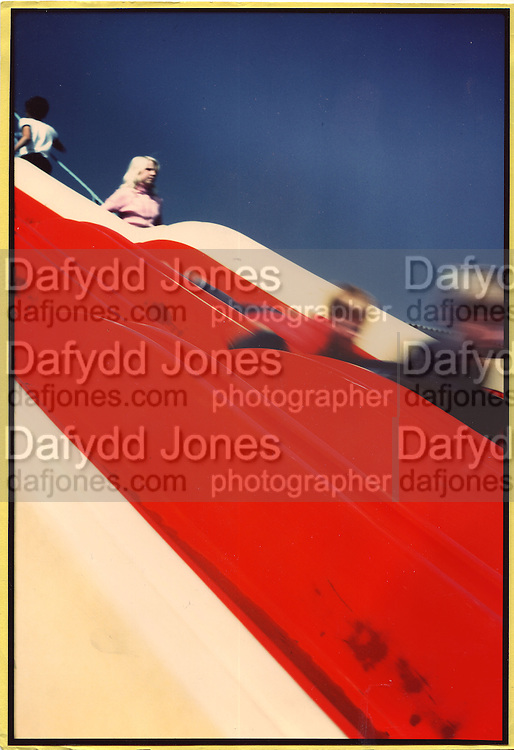 Slide at Bultins Holiday camp Minehead 1979.ONE TIME USE ONLY - DO NOT ARCHIVE  © Copyright Photograph by Dafydd Jones 66 Stockwell Park Rd. London SW9 0DA Tel 020 7733 0108 www.dafjones.com