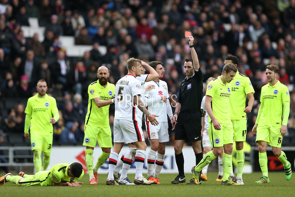 Milton Keynes Dons defender Kyle McFadzean (5) is shown a red card during the Sky Bet Championship match between Milton Keynes Dons and Brighton and Hove Albion at stadium:mk, Milton Keynes, England on 19 March 2016.