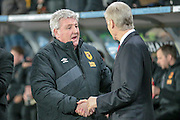 Steve Bruce (Hull City) and Arsène Wenger (Arsenal) shake hands before the The FA Cup fifth round match between Hull City and Arsenal at the KC Stadium, Kingston upon Hull, England on 8 March 2016. Photo by Mark P Doherty.