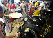 WATFORD HERTFORDSHIRE: Voulunteers prepares puris in the kitchens. Over 55,000 pilgrims and guests visit the Largest Hindu Festival in Europe at Bhaktivedanta Manor Krishna Temple near Watford on Sunday 5th September to celebrate Janmashtami the birth of Lord Krishna. The Manor was donated to the Hare Krishna Movement in the early 1970s by former Beatle George Harrison. 03 SEPT 2010. STEPHEN SIMPSON ..