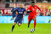 Tottenham Hotspur midfielder Lucas Moura (27) tussles with Bayern Munich midfielder Alphonso Davies (19) during the Champions League match between Bayern Munich and Tottenham Hotspur at Allianz Arena, Munich, Germany on 11 December 2019.