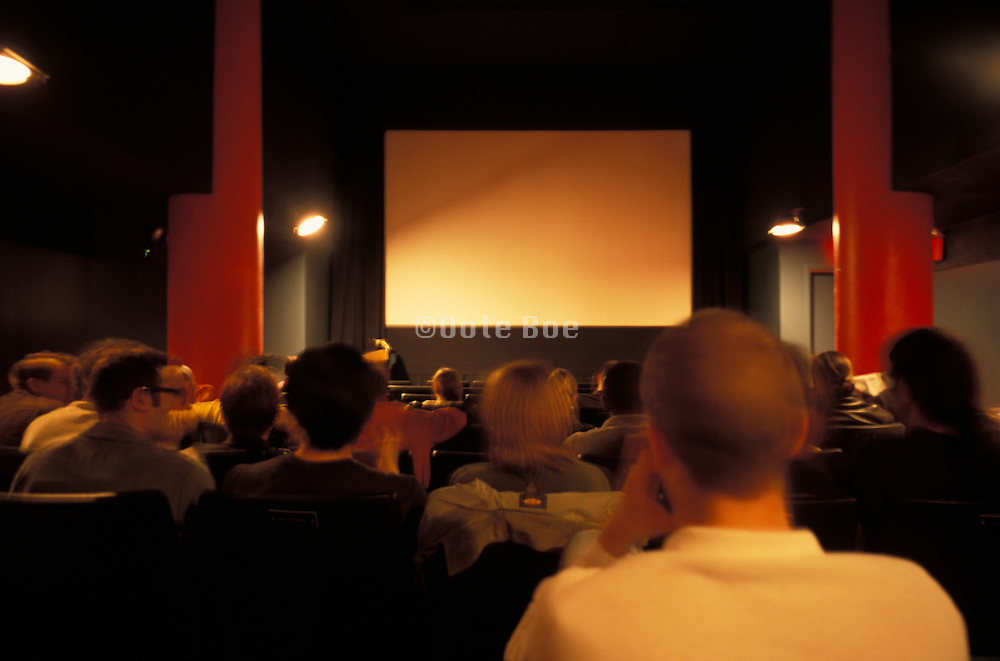 People waiting for a film to begin