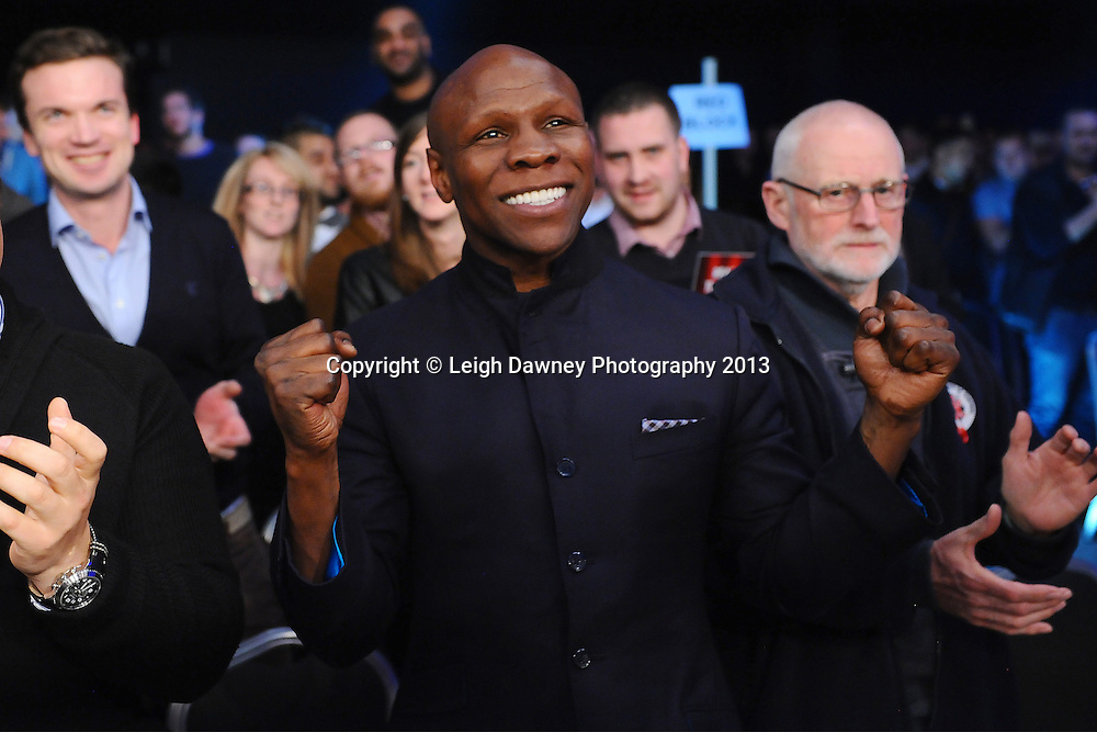Former boxer Chris Eubank celebrates ringside as his son (Chris Eubank Jnr) defeats Frankie Borg by way of knock out in a Middleweight contest. Glow, Bluewater, Kent, UK. Hennessy Sports © Leigh Dawney Photography 2013.