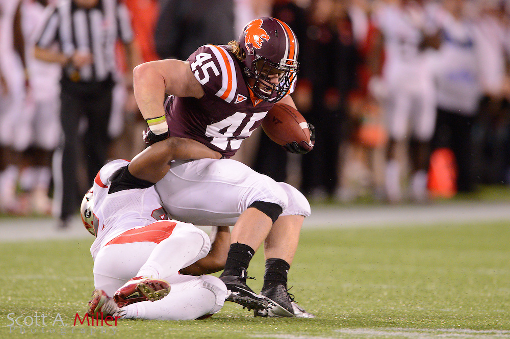 Virginia Tech Hokies fullback Joey Phillips (45) is tackled by Rutgers Scarlet Knights linebacker Steve Beauharnais (42) during the Russell Athletic Bowl on Dec 28, 2012 in Orlando, Florida. Virginia Tech won 13-10 in overtime....©2012 Scott A. Miller..
