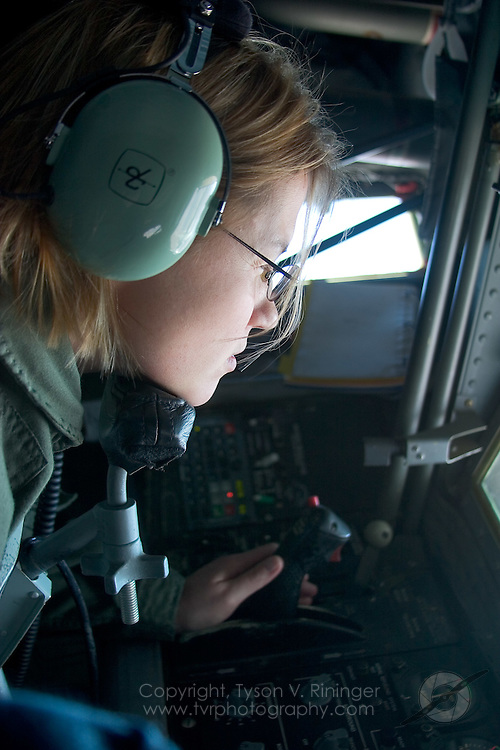 MSgt Sheri Shaw rests her chin while cautiously guiding the refueling probe into an F-16's recepticle high over the Nellis Range. Located in the rear belly of the KC-135, the boomer lies flat while 'flying' the boom into the receptacle controlling two wings half way up the refueling probe. Without the support aircraft assisting red and blue air, Red Flag would be nowhere near as successful a program as it is today.