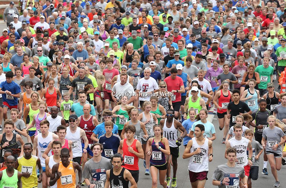 Hundreds of runners break from the startingline for the annual Gumtree 10K on Saturday.